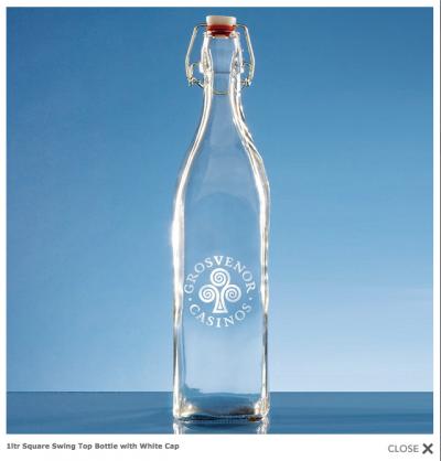 Flip top glass bottle